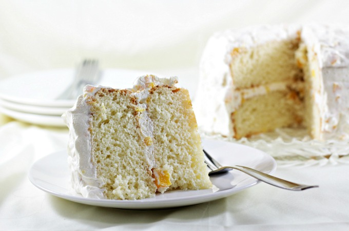 Peachy Keen Cake with Cool Whip Frosting requires a boxed cake mix, canned peaches, peach yogurt and Cool Whip. It makes a boxed cake mix taste homemade.