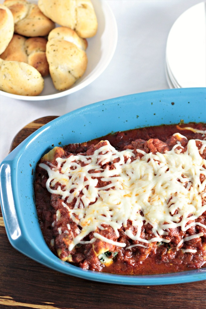 Spinach Manicotti features ricotta, mozzarella, and Parmesan cheese, spinach, jar sauce and is a super easy meatless dish that is also very nutritious.