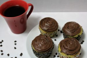 This easy recipe uses bananas and chocolate chips to transform a Betty Crocker boxed yellow cake mix into tasting homemade and premade frosting makes it so easy.