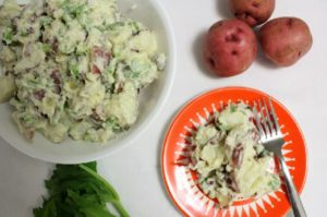 This potato salad recipe combines mayo and nonfat yogurt to make a lighter version of the classic dish. Great for summer barbecues and grilling or picnics.