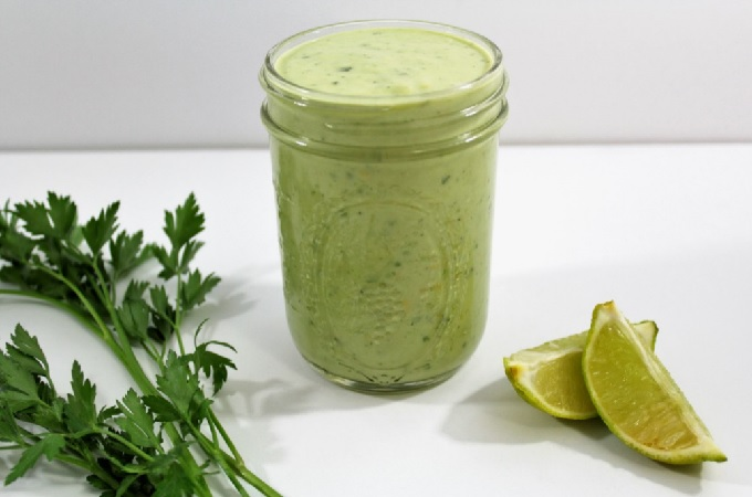 Avocado Lime Ranch Dressing combines avocados, lime juice, yogurt, mayo, milk and Hidden Valley Ranch dressing mix to make this versatile dressing.