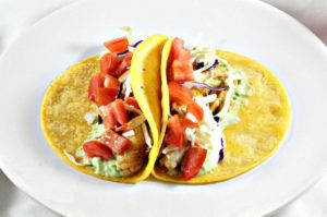 These Fish Tacos are to die for! Cumin, chili and garlic powder, lime juice and super delicious avocado cream make these so delicious, and good for you too!
