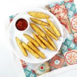 Potato Wedges are drizzled with olive oil, sprinkled with salt, pepper, and paprika and baked to perfection. They are super easy and delicious.