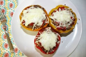Stuffed Bell Peppers are flavorful and filling. It is an impressive dish that is easy to make. Ground beef, tomatoes and cheese give it great flavor.