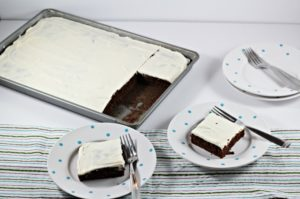 Chocolate Zucchini Cake is moist, decadent and has all the traditional ingredients of classic chocolate cake, with the addition of zucchini and applesauce.