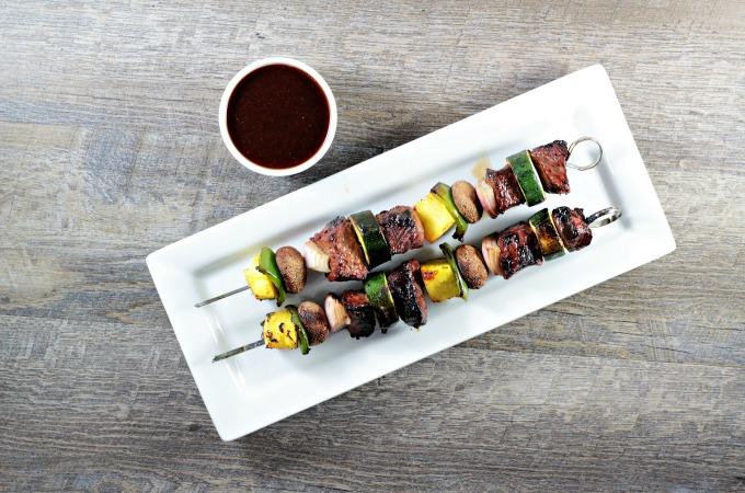Teriyaki Beef Kabobs combine homemade 5-ingredient teriyaki sauce with beef, pineapple, zucchini, mushrooms, red onions, and bell pepper.
