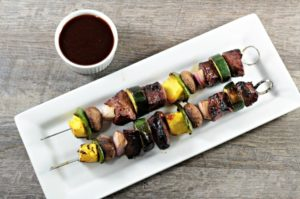 Teriyaki Beef Kabobs combine homemade 5-ingredient teriyaki sauce with beef, pineapple, zucchini, mushrooms, red onions, and bell pepper.
