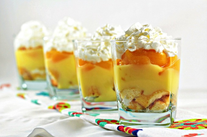 Peach Twinkie Trifle dessert is layered Twinkies, vanilla pudding, and peaches topped with Reddi-Wip. Whip this up in just a few minutes!