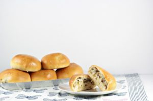 Bierocks are a soft yeast dough pastry sandwich filled with cabbage, ground beef, onion, and cheese. This dish is popular among the German community.