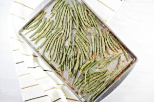 Easy Parmesan Roasted Green Beans are coated with a mixture of olive oil, bread crumbs, cheese, Italian seasoning, salt, and pepper. Simple and delicious!