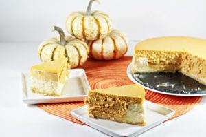 Pumpkin Layered Cheesecake has a shortbread crumb crust with a layer of regular cheesecake and a layer of pumpkin cheesecake. So creamy and delicious!