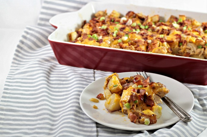 Loaded Chicken Potato Bake: Chicken and potatoes tossed with olive oil and seasonings, then topped with bacon, scallions, and melted cheese. So easy!
