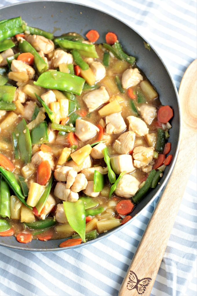 Pineapple Chicken Stir Fry combines chicken, carrots, bell peppers, snow peas, pineapples and juice, soy sauce, and broth. Healthy, quick and delicious!