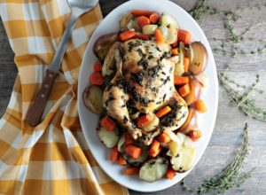 Roasted Chicken, Potatoes, & Carrots: Whole chicken, red potatoes, carrots, onion, olive oil, thyme, and parsley is all you need to make this meal in a pan!