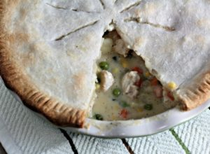 Classic Chicken Pot Pie features store bought crust, cooked chicken, peas, corn, carrots, green beans, and potatoes in a creamy sauce.