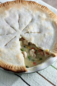 Chicken Pot Pie features store bought crust, cooked chicken, peas, corn, carrots, green beans, and potatoes in a creamy sauce.