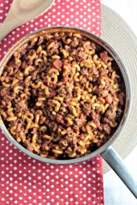 Homemade Hamburger Helper Chili Mac is healthier and only requires ground beef, macaroni, tomatoes, tomato sauce, chili seasoning, milk, and water.