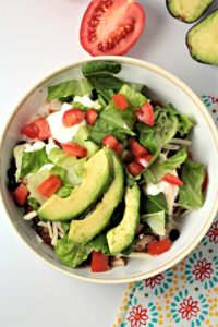 Grilled Chicken Burrito Bowls have rice, beans, chicken, salsa, cheese, lettuce, tomato, sour cream and avocado. A great Mexican meal made at home!