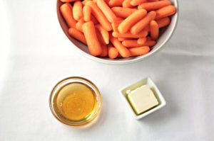 Honey Glazed Baby Carrots combine carrots, butter, and honey to make a delicious and healthy 3 ingredients vegetarian side dish the kids will love.
