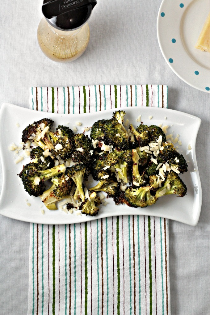 Italian Roasted Broccoli features broccoli tossed in Italian dressing, roasted to perfection and then topped with Parmesan cheese crumbles. So simple!