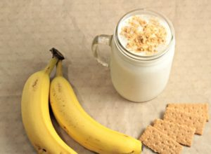 Banana Cream Pie Smoothie combines frozen bananas, vanilla Greek yogurt, honey, milk and ice. Topped with graham cracker crumbs. Great for weight loss!