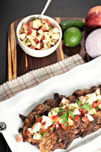 Spicy Grilled Pork Chops with Apple Salsa features marinated pork and an apple salsa made with fresh fruits and vegetables. Impressive and delicious!