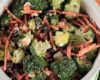 Broccoli Salad with Creamy Feta Dressing combines fresh broccoli, bell pepper, carrots, craisins, yogurt, lemon juice and pepper to make an easy side dish.