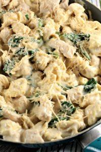 Chicken Spinach Tortellini Alfredo is chicken, jar sauce, milk, cheese tortellini, spinach and Parmesan cheese and is on the table in about 30 minutes!