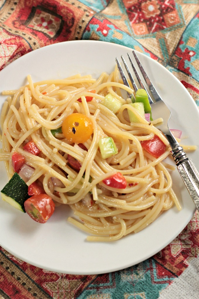 Garden-Fresh Spaghetti Salad: Spaghetti, zucchini, cucumber, red and green bell pepper, cherry tomatoes, red onion, Italian dressing and Parmesan cheese.