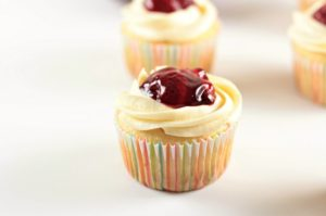Strawberry Cheesecake Cupcakes transform a boxed white cake mix into a delicious treat with premade cheesecake filling and strawberry pie filling. So easy!