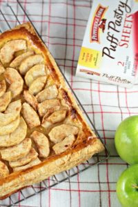 Puff Pastry Apple Tart features puff pastry, Granny Smith apples, cinnamon, sugar and apple jelly. A quick, easy, delicious and impressive recipe!