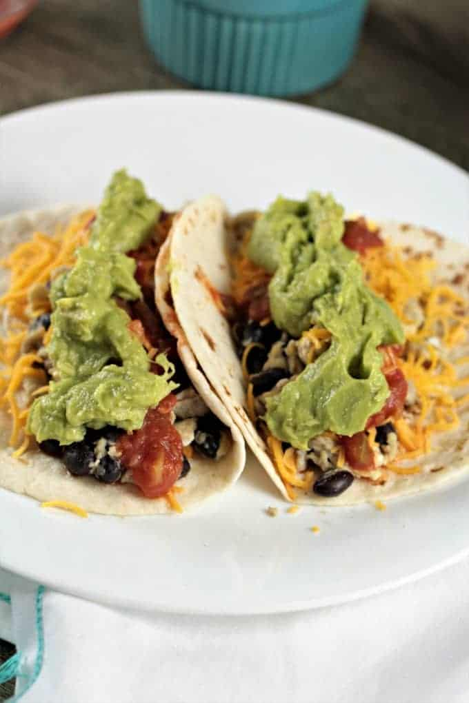 Avocado Breakfast Soft Tacos-scrambled eggs, black beans, cheese, salsa, and avocado atop a warm flour tortilla, perfect breakfast, brunch, lunch or dinner!
